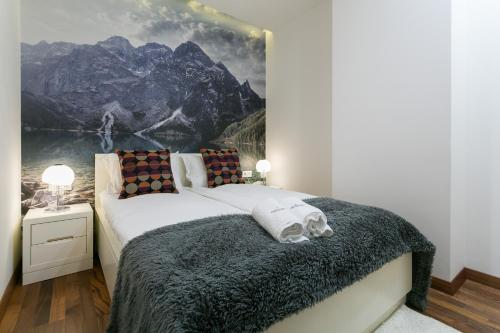 A bed or beds in a room at VIP Apartamenty Gorące Źródła