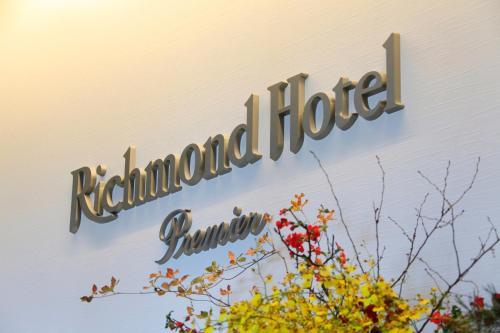 Logo atau tanda untuk hotel ekonomis