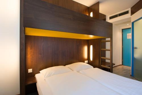 A bed or beds in a room at 7 Days Premium Hotel Linz-Ansfelden