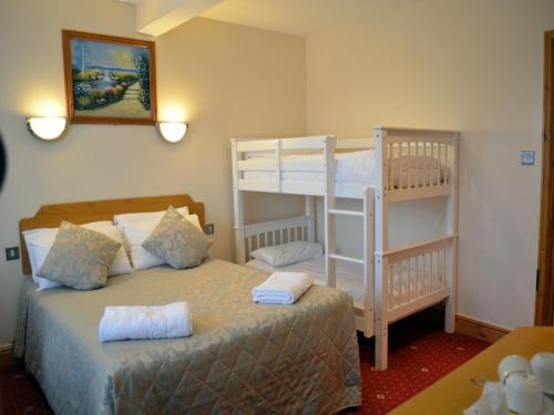A bunk bed or bunk beds in a room at Gatwick Cambridge Hotel