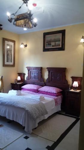 Кровать или кровати в номере Villa Fiorita