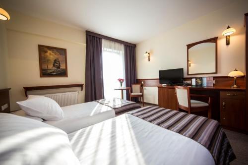 Posteľ alebo postele v izbe v ubytovaní Conrad Hotel