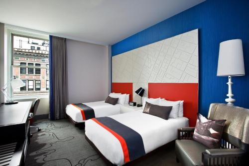 A bed or beds in a room at W New York - Union Square