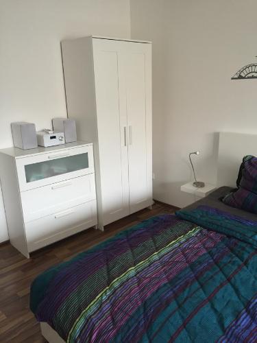 Ein Bett oder Betten in einem Zimmer der Unterkunft City FEWO Leipzig