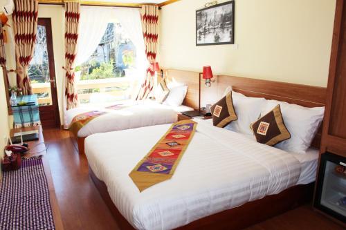 Un ou plusieurs lits dans un hébergement de l'établissement Sapa Dragon Hotel
