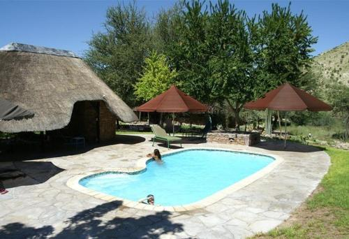 The swimming pool at or near Etusis Lodge