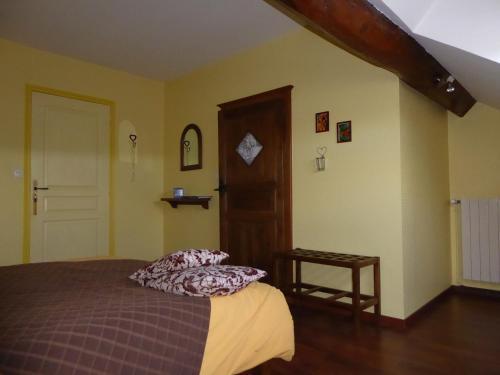 Un ou plusieurs lits dans un hébergement de l'établissement Les Ombelles