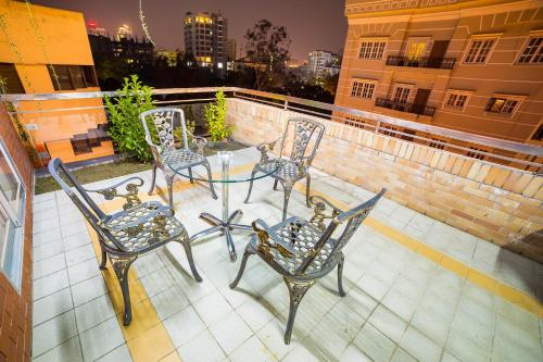 A balcony or terrace at Nascent Gardenia Luxury Suites