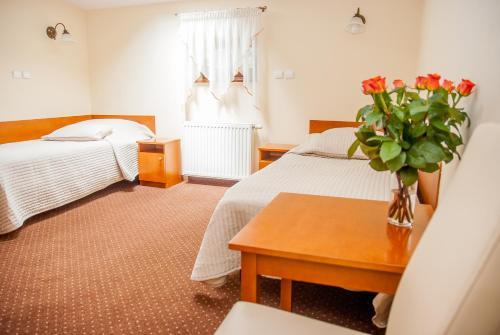 Posteľ alebo postele v izbe v ubytovaní U Pana Cogito