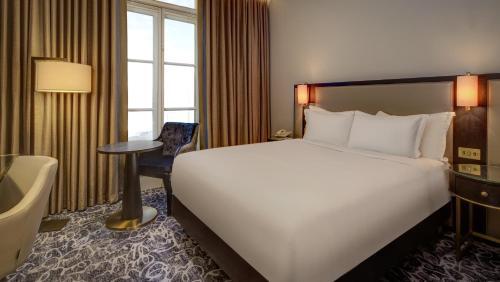 Cama o camas de una habitación en Hilton London Euston