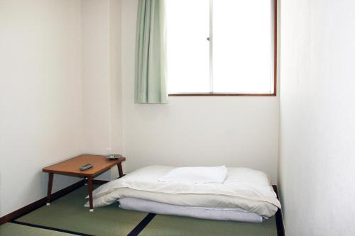 A bed or beds in a room at Hotel Kaga