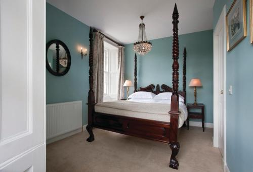 A bed or beds in a room at The Bridge Inn