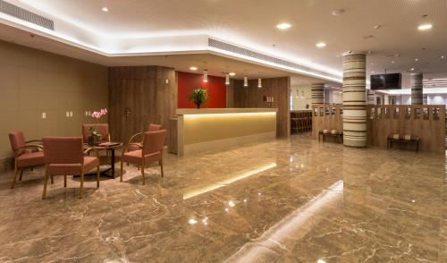The lobby or reception area at Sleep Inn Praia do Canto