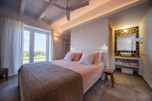 A bed or beds in a room at Agroturismo Son Vives Menorca - Adults Only