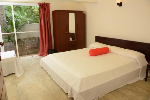 Кровать или кровати в номере Hotel Tobiko
