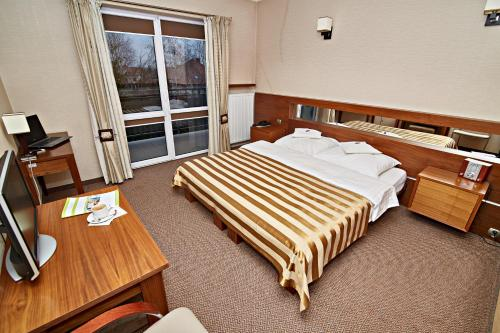 A bed or beds in a room at Hotel Ted