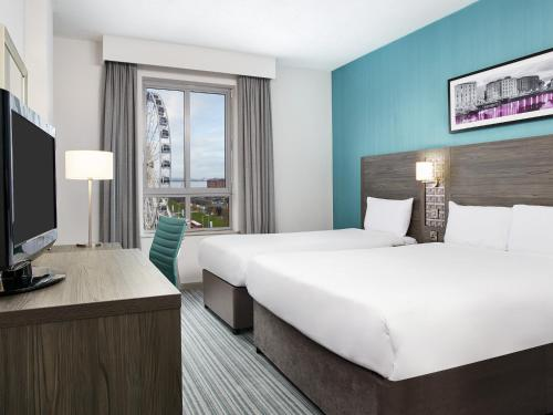 A bed or beds in a room at Jurys Inn Liverpool