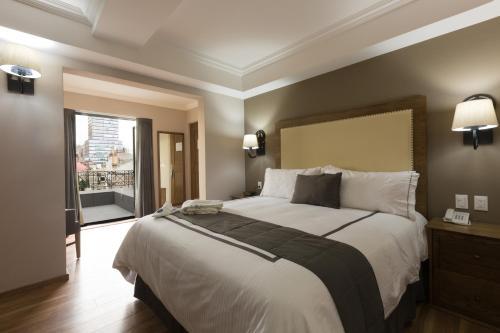 Letto o letti in una camera di Hotel Histórico Central