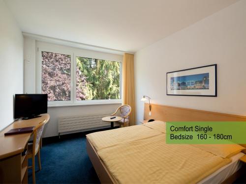 Ein Bett oder Betten in einem Zimmer der Unterkunft Hotel Restaurant Florida