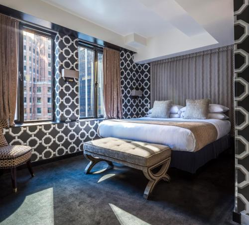 A bed or beds in a room at Room Mate Grace Boutique Hotel