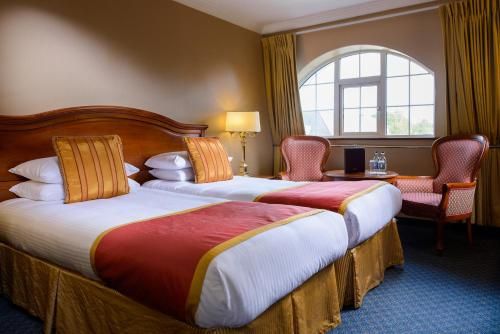 A bed or beds in a room at River Island Hotel