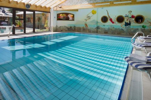 The swimming pool at or near Hotel L'Ensoleillé