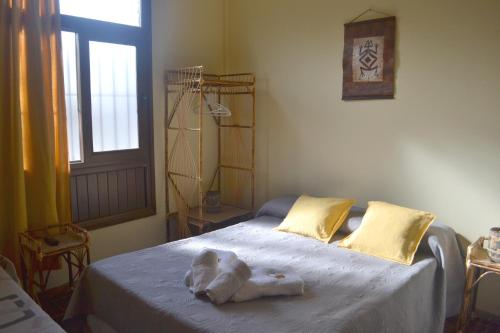 A bed or beds in a room at Apart Hotel Ñusta