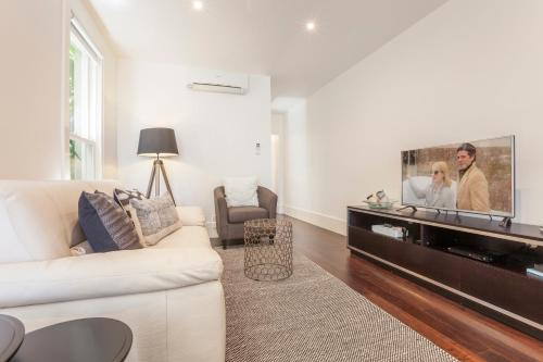 A seating area at Boutique Stays - South Yarra Lane