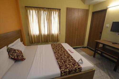 Cama o camas de una habitación en Hotel Vijay
