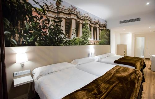 A bed or beds in a room at Hotel BESTPRICE Gracia