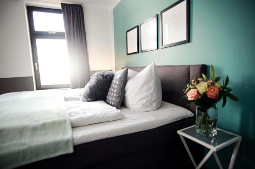 Ein Bett oder Betten in einem Zimmer der Unterkunft Hentschels Apartments