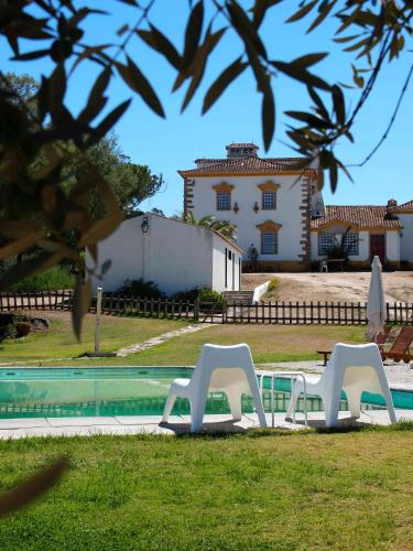 The swimming pool at or near Quinta Dos Ribeiros