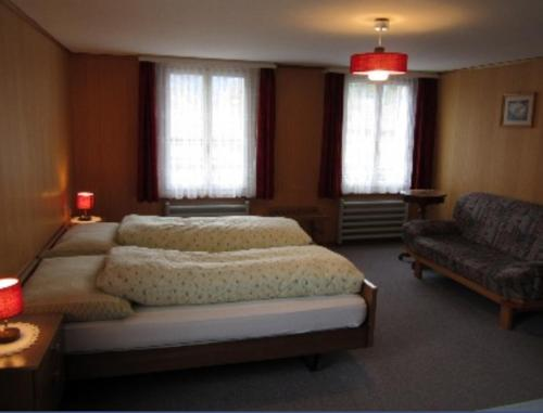 Ein Bett oder Betten in einem Zimmer der Unterkunft Hotel Montana