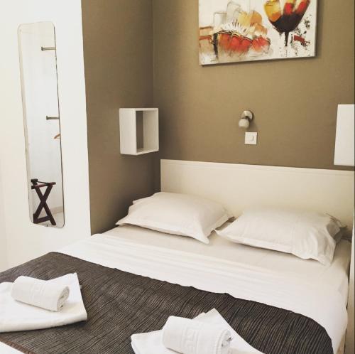 Un ou plusieurs lits dans un hébergement de l'établissement Hotel Danemark