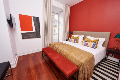 A bed or beds in a room at Martinhal Lisbon Chiado