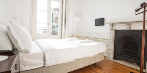 A bed or beds in a room at Porto Republica Hostel & Suites