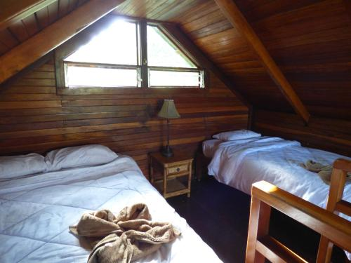 A bed or beds in a room at Corcovado Beach Lodge