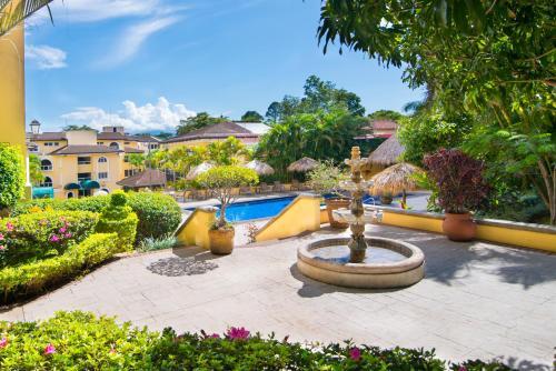 The swimming pool at or near Apartotel & Suites Villas del Rio