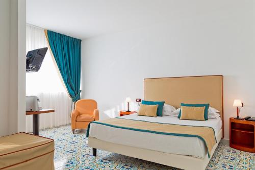 A bed or beds in a room at Mediterranea Hotel & Convention Center