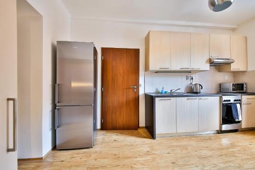 A kitchen or kitchenette at VITOM Apartments Ostrava