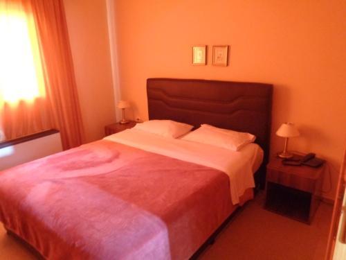 Ένα ή περισσότερα κρεβάτια σε δωμάτιο στο Ξενοδοχείο Bell Air