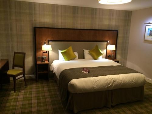 A bed or beds in a room at The Guildhall and Linen Exchange Wetherspoon