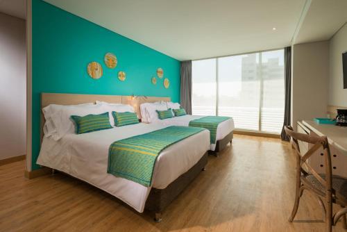 Uma cama ou camas num quarto em bh Barranquilla
