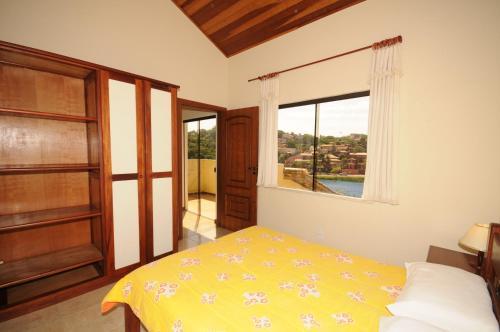 Cama ou camas em um quarto em Condomínio Mares de Búzios