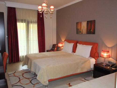 Ένα ή περισσότερα κρεβάτια σε δωμάτιο στο Ξενοδοχείο Φαράγγι