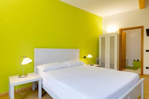 Letto o letti in una camera di B&B al Palazzo Malfatti