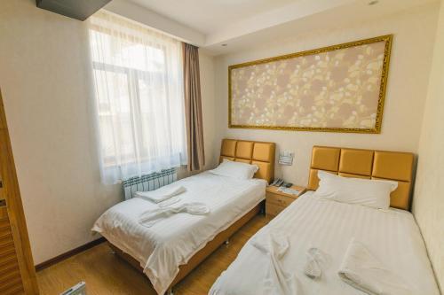 Кровать или кровати в номере Hotel Garden House