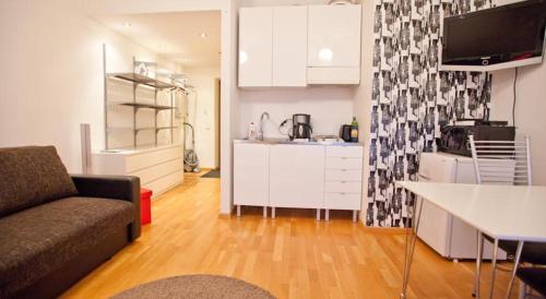 A kitchen or kitchenette at Volta Apartments Lootsi