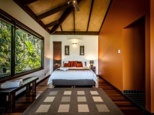 A bed or beds in a room at Lombok on Waterfall