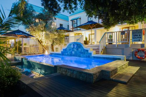 The swimming pool at or close to Protea Hotel by Marriott Dorpshuis & Spa Stellenbosch